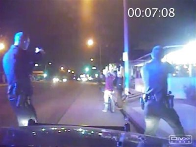 In this June 2, 2013, frame from Gardena Police Department dash-cam video, officers aim their guns at Ricardo Diaz-Zeferino, right, and two friends while investigating a bicycle theft in Gardena, Calif. Moments later police fatally shot Diaz-Zeferino. Hours after a federal judge ordered the release of videos sought by The Associated Press and other news organizations Tuesday, July 14, 2015, a federal appeals court has issued a stay blocking release of the video. (Gardena Police Department)