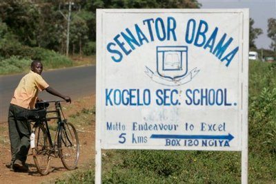 In this Tuesday, Feb. 5, 2008 file photo, a boy pushes his bicycle past a sign for the Senator Obama secondary school in the village of Kogelo, Kenya where Barack Obama's grandmother lives. Barack Obama, the United States' first African-American president, has captured the imagination of people across the continent where his face shows up on billboards, backpacks, T-shirts and restaurants.  On Friday, July 24, 2015 Obama will be visiting Kenya, where his father was born, for a summit on entrepreneurship before heading to Ethiopia to address leaders at the African Union headquarters. Wherever he goes, large crowds are expected to gather and cheer him. (AP Photo/Ben Curtis, file)