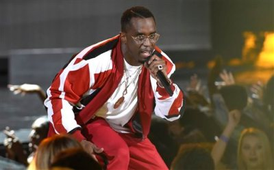 """In this Sunday, June 28, 2015 file photo, Sean """"Diddy"""" Combs performs at the BET Awards at the Microsoft Theater in Los Angeles. The Los Angeles County district attorney's office has declined to file felony charges against Combs for a confrontation last month at the University of California, Los Angeles, where his son plays football. District Attorney spokesman Ricardo Santiago said Thursday, July 2, 2015, his office has decided instead to turn the case over to the Los Angeles city attorney's office. (Photo by Chris Pizzello/Invision/AP, File)"""