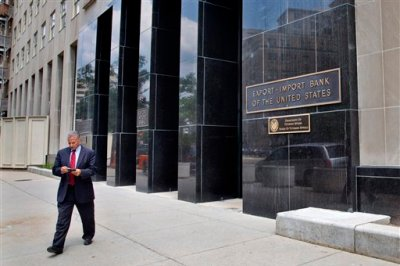 A man walks out of the Export-Import Bank of the U.S., Tuesday, July 28, 2015, in Washington. The federal Export-Import Bank expired June 30 when Congress failed to renew its charter. The bank is a small federal agency that helps U.S. companies sell their products overseas, by underwriting loans to foreign customers. Conservatives oppose it as corporate welfare and are pushing to keep it dead. But late Monday the Senate voted 64-29 to add legislation reviving the bank to a sweeping highway bill being considered on the floor. (AP Photo/Jacquelyn Martin)