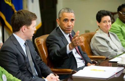 President Barack Obama, center, with Paul Sullivan, left, Vice President of International Business Development at Acrow Bridge, and Susan Jaime, right, CEO Ferra Coffee International, during his meeting with small business owners to discuss the importance of the reauthorization of the Export-Import Bank in the Roosevelt Room of the White House in Washington, Wednesday, July 22, 2015. Obama is ramping up pressure on Congress to reauthorize the Export-Import Bank, the obscure federal agency's charter expired last month after lawmakers refused to reauthorize it. The bank underwrites loans to foreign companies purchasing American products, but conservatives call it corporate welfare. (AP Photo/Pablo Martinez Monsivais)