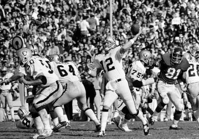 Quarterback Ken Stabler (12) of the Oakland Raiders gets off his pass behind perfect protection, as his team completes another touchdown en route to a 32-14 victory over the Minnesota Vikings in Super Bowl XI in Pasadena, Calif., Jan. 9, 1977. (Associated Press)