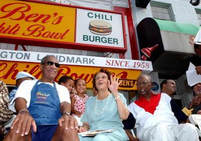 Bill Cosby, left, joins Ben Ali, right, and Ali's wife, Virginia, during a celebration on the 45th anniversary of Ben's Chili Bowl on Aug. 22, 2003. (Dennis Cook/Associated Press)
