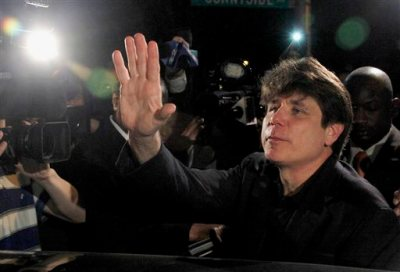 In this March 15, 2012 file photo, former Illinois Gov. Rod Blagojevich waves as he departs his Chicago home for Littleton, Colo., to begin his 14-year prison sentence on corruption charges. The 7th U.S. Circuit Court of Appeals in Chicago on Tuesday, July 21, 2015, tossed out some of Blagojevich's convictions that he sought to sell or trade President Barack Obama's old U.S. Senate seat. (AP Photo/Charles Rex Arbogast, File)