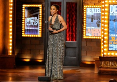 """Sophie Okonedo accepts the award for best performance by an actress in a featured role in a play for """"A Raisin in the Sun"""" on stage at the 68th annual Tony Awards at Radio City Music Hall on Sunday, June 8, 2014, in New York. (Photo by Evan Agostini/Invision/AP)"""