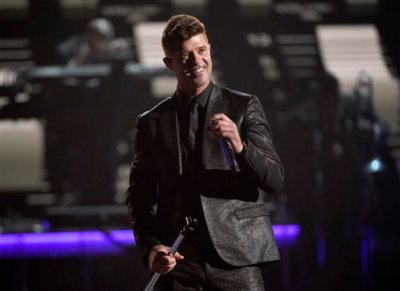 """In this Sunday, June 28, 2015 file photo, Robin Thicke performs during a tribute to Smokey Robinson at the BET Awards at the Microsoft Theater in Los Angeles. A federal judge in Los Angeles on Tuesday, July 14, 2015, trimmed a copyright infringement verdict against Thicke and Pharrell Williams over their 2013 hit """"Blurred Lines"""" from nearly $7.4 million to $5.3 million. The ruling also gives Marvin Gaye's family, which sued the singers over the song, an ongoing shared of royalties from """"Blurred Lines.""""  (Photo by Chris Pizzello/Invision/AP, File)"""