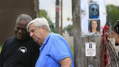 Dave Lawrence, right, and Steven Goodin share a moment after a prayer at the site where Lawrence's 16-year-old granddaughter Paige Stalker was killed. (Carlos Osorio/AP Photo)