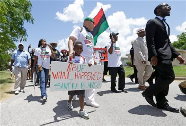 Protesters Kofi Taharka with William Mitchell, march with others from Waller County Jail to the Waller County Courthouse in Hempstead, Texas, Friday July 17, 2015, to protest the death of Sandra Bland, who was found dead in the jail. Waller County District Attorney Elton Mathis said there were no cameras in Bland's jail cell to show if the Illinois woman hanged herself in the lockup as a medical examiner has ruled. Her relatives and supporters dispute the finding. (Melissa Phillip/Houston Chronicle via AP) MANDATORY CREDIT