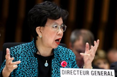In this Sunday, Jan. 25, 2015 file photo, China's Margaret Chan, Director General of the World Health Organization, WHO, addresses her statement during the special session on Ebola of the Executive Board, at the headquarters of the WHO in Geneva, Switzerland. An experimental vaccine tested on thousands of people in Guinea exposed to Ebola seems to work and might help shut down the ongoing epidemic in West Africa, according to interim results from a study published Friday, July 31, 2015.  (Salvatore Di Nolfi/Keystone via AP, File)