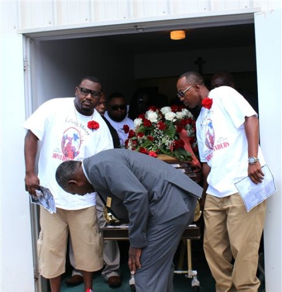 Pallbearers bring out the casket containing the body of Stonewall, Miss., resident Jonathan Sanders following his funeral services Saturday, July 18, 2015, at the Family Life Center in Quitman, Miss. Sanders, who had been driving a horse and buggy died after a fight with a Stonewall police officer. (Jeff Byrd/The Meridan Star via AP)