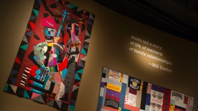 Quilts from the Bill and Camille Cosby collection hang at the Smithsonian's National Museum of African Art in Washington in this Nov. 6, 2014, file photo. (AP Photo/Evan Vucci)
