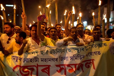 Activists hold a torch protest against the lynching of a man accused of rape in Gauhati. (AP Photo)
