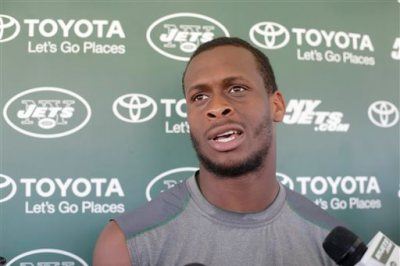 In this Aug. 4, 2015, file photo, New York Jets quarterback Geno Smith responds to questions during a news conference after practice at NFL football  training camp in Florham Park, N.J. Jets quarterback Geno Smith will be sidelined at least 6-10 weeks after being punched in the jaw by teammate Ikemefuna Enemkpali. Coach Todd Bowles made the announcement before training camp practice Tuesday, Aug. 11, 2015. (AP Photo/Frank Franklin II, File)
