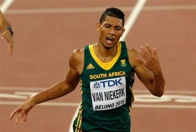 South Africa's Wayde Van Niekerk crosses the line to take the gold medal in the men's 400m final during the World Athletics Championships at the Bird's Nest stadium in Beijing, Wednesday, Aug. 26, 2015. (AP Photo/Mark Schiefelbein)