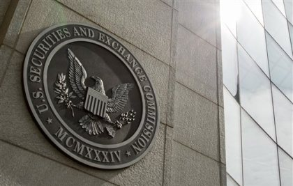 This June 19, 2015 file photo shows the seal of the U.S. Securities and Exchange Commission at SEC headquarters, in Washington. The Securities and Exchange Commission on Wednesday, Aug. 5, 2015 voted to order most public companies to disclose the ratio between their chief executives' annual compensation and median, or midpoint, employee pay. The new rule will take effect starting in 2017. (AP Photo/Andrew Harnik, File)