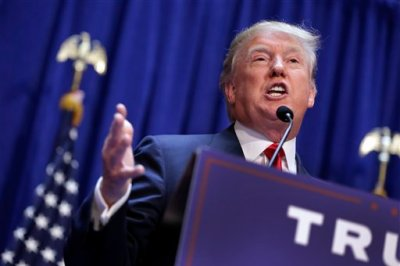 In this June 16, 2015 file photo, Donald Trump announces that he seek the Republican nomination for president, in the lobby of Trump Tower in New York. Trump vows to bring back the millions of American jobs lost to China and other foreign competitors if voters put him in the White House. Economists say he wouldn't stand a chance: Trump's boundless self-confidence is no match for the global economic forces that took those jobs away. (AP Photo/Richard Drew, File)