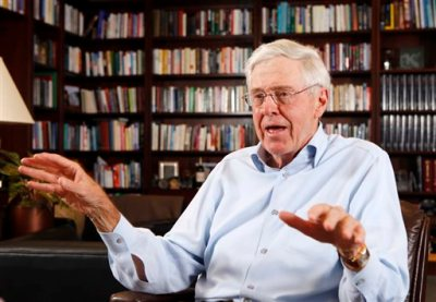 """In this May 22, 2012, file photo, Charles Koch speaks in his office at Koch Industries in Wichita, Kan. Koch, a billionaire industrialist, warned America is """"done for"""" if the conservative donors and politicians he gathered at a retreat this weekend don't rally others to their cause of demanding a smaller, less-intrusive government. (Bo Rader/The Wichita Eagle via AP, File)"""