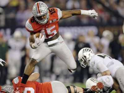 Ezekiel Elliott (15) is one of at least three potential legitimate Heisman trophy candidates on Ohio State's roster. (Eric Gay/AP Photo)