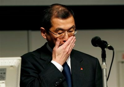 In this Thursday, June 25, 2015, file photo, Japanese seat belt and air-bag maker Takata Corp. Chairman and CEO Shigehisa Takada gestures during a news conference regarding the expanding recall of his company's air bags in Tokyo. The 2015 American Consumer Satisfaction Index found that satisfaction with automobiles dropped for the third straight year to the lowest level since 2004. Last year automakers recalled a record 64 million vehicles for problems such as exploding air bags, including Takata air bags. (AP Photo/Shuji Kajiyama, File)
