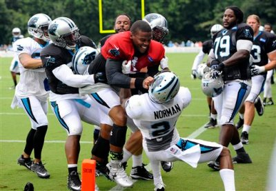 Carolina Panthers' Cam Newton (1) and Josh Norman (24) scuffle at the teams NFL football training camp at Wofford College in Spartanburg, S.C., Monday, Aug. 10, 2015. (David T. Foster III/The Charlotte Observer via AP)