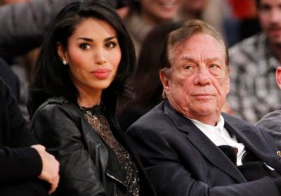 "In this Dec. 19, 2010, file photo, Los Angeles Clippers owner Donald Sterling, right, and V. Stiviano, left, watch the Clippers play the Los Angeles Lakers during an NBA preseason basketball game in Los Angeles. Sterling sued celebrity website TMZ and an ex-girlfriend over the recording of his off-color remarks that cost him ownership of the Los Angeles Clippers. Sterling's lawsuit filed Friday, Aug. 7, 2015, in Los Angeles Superior Court accused TMZ and V. Stiviano of violating his privacy and causing damage on a ""scale of unparalleled and unprecedented magnitude."" (AP Photo/Danny Moloshok, File)"