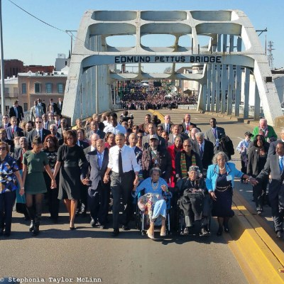 Boynton, in wheelchair next to President Obama, at 50th anniversary celebration of the Selma to Montgomery March (Photo by Stephonia Taylor McLinn)