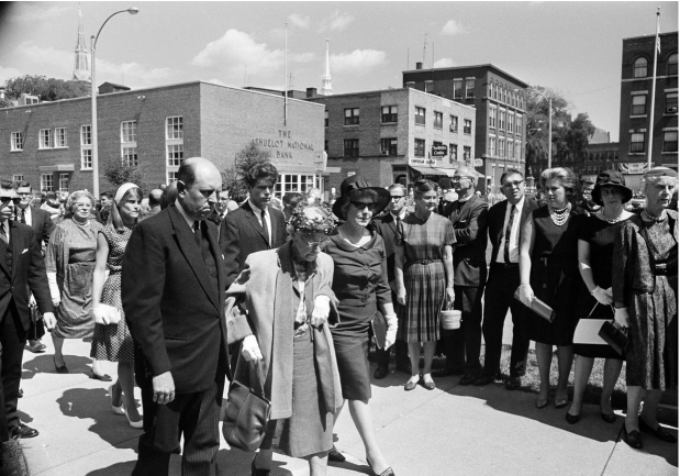 Connie Daniels, right, mother of Jonathan Daniels, the young seminarian and civil rights worker slain in Hayneville, Ala., arrives at church in Keene, N.H., on Aug. 24, 1965, to attend her son's funeral. (Bill Chaplis/AP)