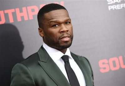 """In this July 20, 2015, file photo, Actor Curtis """"50 Cent"""" Jackson attends the premiere of """"Southpaw"""" at the AMC Loews Lincoln Square in New York. The rapper says in a Connecticut bankruptcy court filing Monday, Aug. 3, he spends about $108,000 a month on his expenses, including $5,000 for gardening. (Photo by Evan Agostini/Invision/AP, File)"""