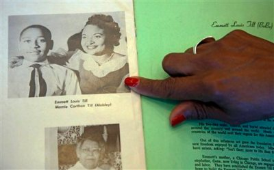 Deborah Watts of Minneapolis, points out a widely seen 1950s photograph of her cousin Emmett Till and his mother Mamie Till Mobley, during a visit to Jackson, Miss., Thursday, Aug. 27, 2015 in conjunction with events in Mississippi and Illinois commemorating the 60th anniversary of the slaying of Till, a black 14-year-old from Chicago who was visiting relatives in the Mississippi Delta when witnesses said he violated the Jim Crow social code by whistling at a white woman. He was kidnapped and killed Aug. 28, 1955, and his body was recovered from the Tallahatchie River three days later. An all-white jury acquitted two white men charged in the slaying. (AP Photo/Rogelio V. Solis)