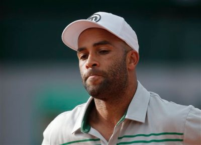 In this May 26, 2013, file photo, James Blake grimaces after missing a return against Serbia's Viktor Troicki at the French Open tennis tournament in Paris. Internal affairs detectives are investigating claims by former tennis professional James Blake that he was thrown to the ground and then handcuffed while mistakenly being arrested Wednesday, Sept. 9, 2015, at a New York hotel, police said. Blake, who's biracial, told the Daily News he wasn't sure if he was arrested because of his race but said the officer who put him in handcuffs inappropriately used force. (AP Photo/Michel Spingler, File)