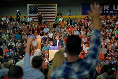 Audience members raise their hands during a question and answer session with Republican presidential candidate Donald Trump at a town hall event Thursday, Sept. 17, 2015, in Rochester, N.H. (AP Photo/Robert F. Bukaty)