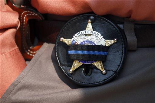 Officer Shot Manhunt
