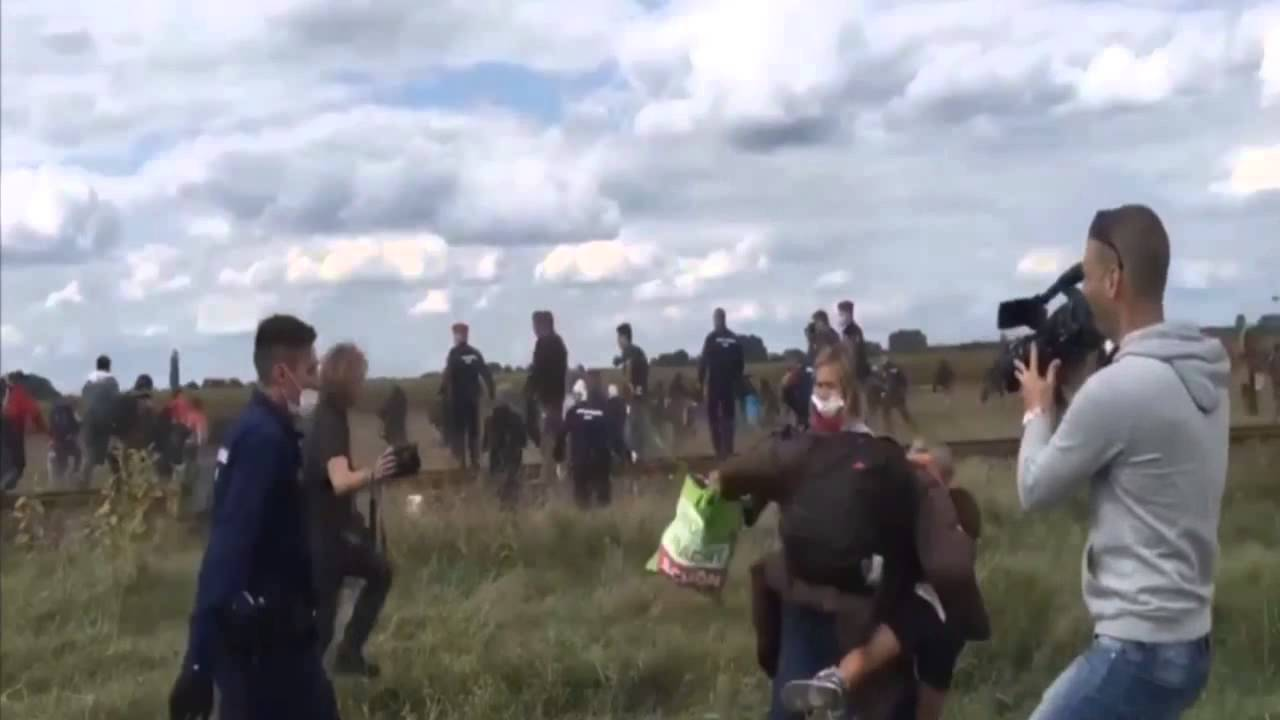 Camerawoman in Hungary trips and kicks migrants