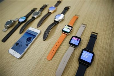 In this Aug. 21, 2015, Android Wear smartwatches compatible with the Apple iPhone are displayed at Google's offices in San Francisco. Google is introducing an application that will connect Android smartwatches with Apple's iPhone, escalating the rivals' battle to strap their technology on people's wrists. (AP Photo/Eric Risberg)