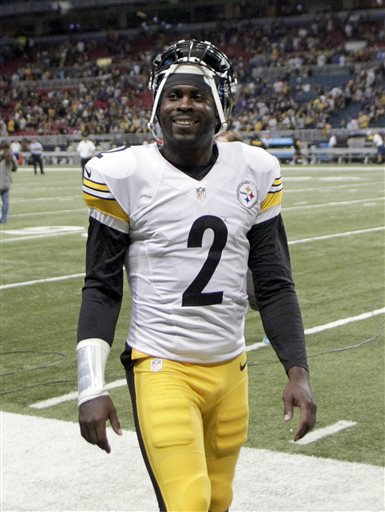 Pittsburgh Steelers quarterback Michael Vick smiles as he walks off the field following an NFL football game against the St. Louis Rams, Sunday, Sept. 27, 2015, in St. Louis. Vick came into the game after Steelers starting quarterback Ben Roethlisberger was injured. (AP Photo/Tom Gannam)