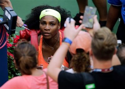 Serena Williams looks up at fans as she leaves the court after beating Kiki Bertens, of the Netherlands, during the second round of the U.S. Open tennis tournament, Wednesday, Sept. 2, 2015, in New York. (AP Photo/Matt Rourke)