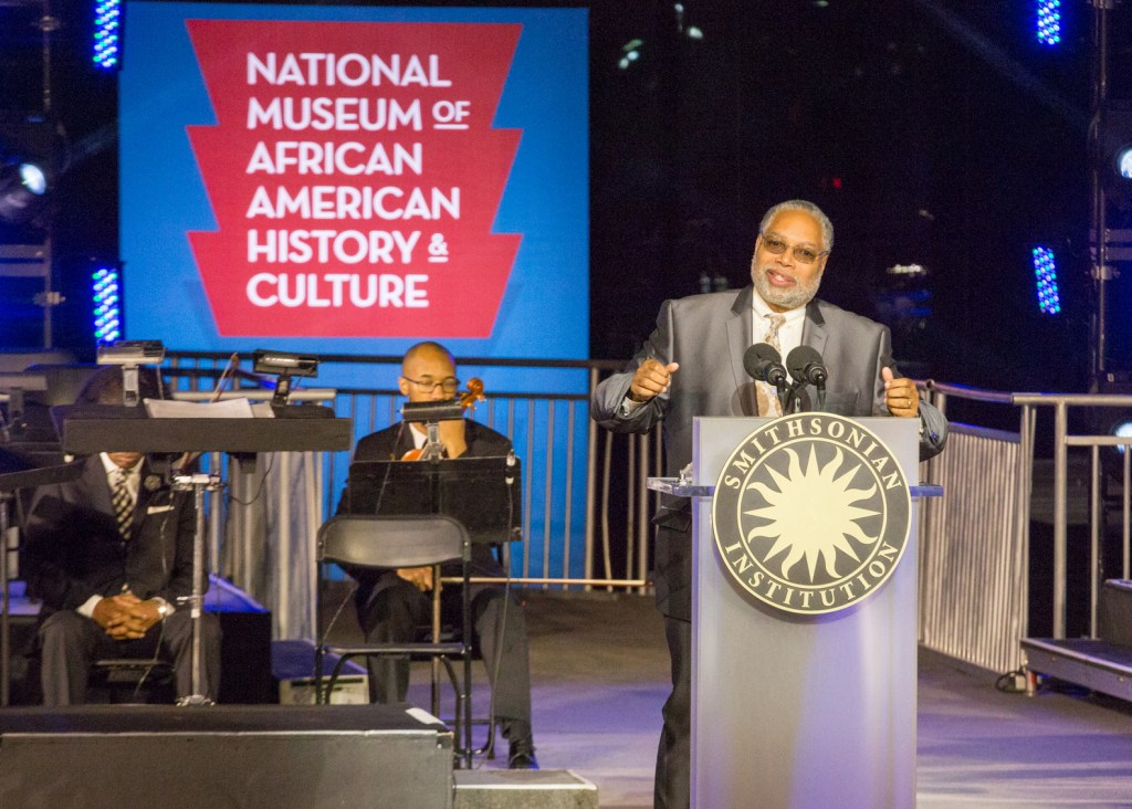 Lonnie Bunch, the founding director of the Smithsonian Institution's National Museum of African American History and Culture welcomes guests to the museum's special ceremony outside of the Smithsonian's newest museum that is scheduled to open in Fall 2016. (Cheriss May/HUNS)