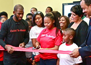 NBA Superstar Chris Paul (left) partnered with State Farm and Jordan Brand's WINGS to donate a computer lab with state of the art equipment to the Brotherhood Crusade. (L.A. Watts Times)