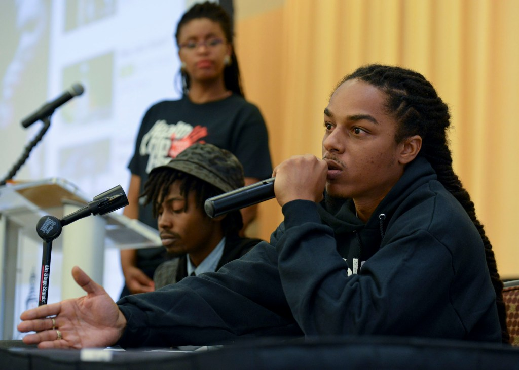 """Messaiah Ramiskoon, an MC, youth advocate and three-time winner of """"Showtime at the Apollo,"""" comments on homophobia in Hip Hop at the Health and Hip Hop Conference at Morgan State University in Baltimore, Md. (Freddie Allen/BAI)"""