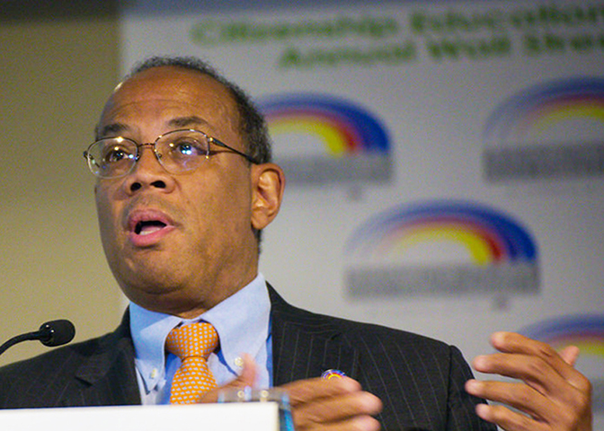 "John Rogers, CEO of Ariel Investments, said that even with a Black man in the White House, Wall Street can feel like ""modern day Jim Crow."" In this 2015 photo, Rogers speaks at the 18th Annual Rainbow Push Wall Street Project Economic Summit. (Rainbow PUSH Coalition)"