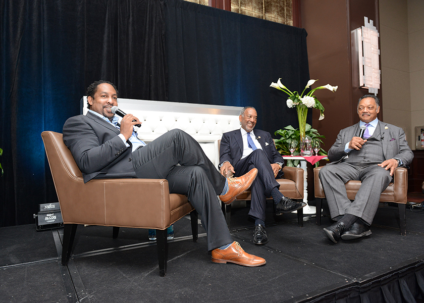 """From left to right: Journalist Navarrow Wright, John Thompson of Microsoft and Rev. Jesse Jackson, Sr. speak during a """"fireside chat"""" at the Wall Street Project Economic Summit in New York City. (Margot Jordan/RPC)"""