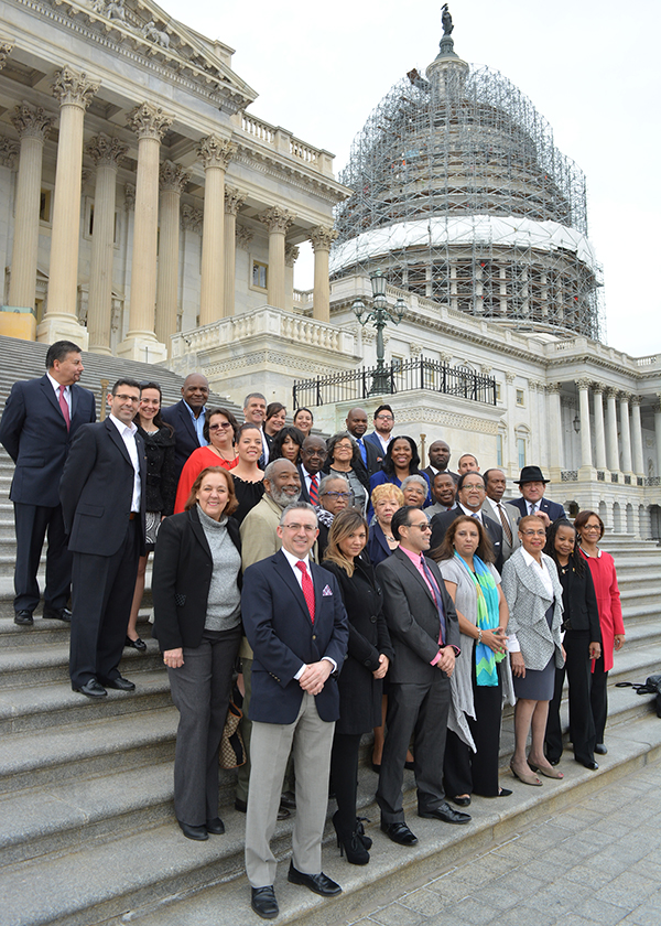 Washington, D.C. Congresswoman Eleanor Holmes Norton (first row, 3rd from right) poses for a picture on the steps of the U.S. Capitol with members of the National Newspaper Publishers Association and the National Association of Hispanic Publications. The congresswoman joined the groups for a press conference on economic inclusion and minority businesses. (Roy Lewis/NNPA)