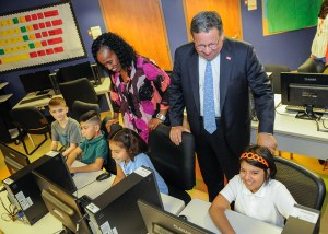 Six-time Olympic medal winner Jackie Joyner-Kersee (left) and David L. Cohen, the senior executive vice president of Comcast Corporation visit children in a computer lab. (Comcast)