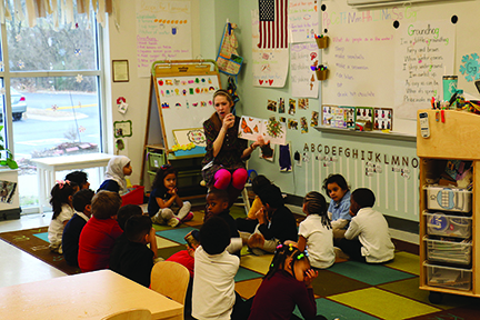Four-year olds sit for a pre-school staple: listening to a story.