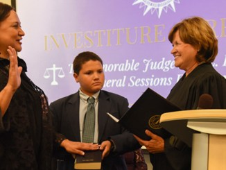 (l-r): Judge Ana L. Escobar, Judge Escobar's son Conner Burchwell, and Justice Sharon G. Lee of the Tennessee Supreme Court.