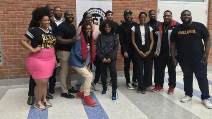 "The Hustler's Guild team and panelists after the panel, ""State of the Culture: Tech in Hip Hop & Mental Health in the Black youth community"" at Roosevelt High School in Northwest, D.C. (Courtesy Photo)"