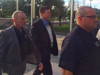 OFFICER JASON VAN DYKE photographed arriving at the Leighton Criminal Courthouse with his attorney on September 10, 2018.