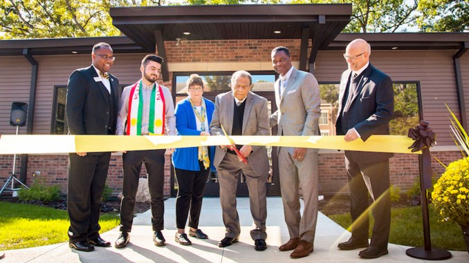 OFFICIALS PARTICIPATING IN the Ribbon Cutting after the Dedication Ceremony for the Jean Childs Young Intercultural Center are from left to right: Michael Dixon, Chief Diversity Officer, Manchester University; Dzhwar Hamad, student; Jo Young Switzer, President Emerita, Manchester University; Ambassador Andrew Young; Al Smith, Group Vice President and Chief Social Innovation Officer, Toyota Motor North America; and Dr. Dave McFadden, President, Manchester University.
