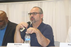 Eric Huth represents Nashville teachers. The town hall meeting took place at the NEA hall.
