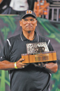 Bengals Hall of Famer Anthony Munoz held the 1988 A.F.C championship trophy when the Super Bowl team was introduced. Photo by Michael Mitchell